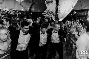 Groomsmen dancing.