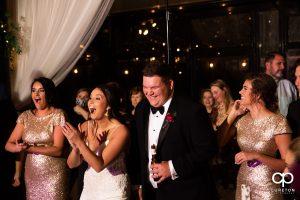 Bride and groom cheering.