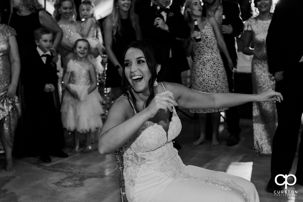 Groomsmen dancing for the bride.