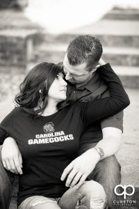 Black and white photo of an engaged couple.