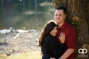 Engaged couple by the lake at Furman.