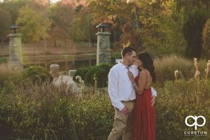 Engaged couple by the lake at Furman University.