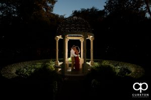 Couple standing in the rose garden during their Furman university engagement session.