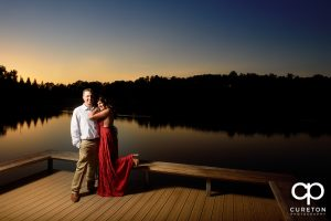 Future bride and groom by the lake at sunset at Furman.