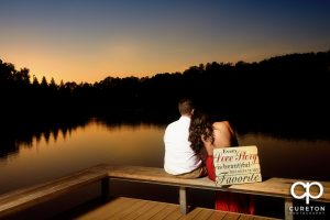 Bride and groom viewing sunset by the lake.