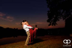 Bride and groom dancing at sunset during their engagement session at Furman university.