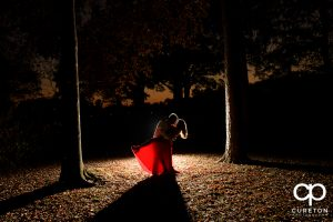 Bride and groom dancing in the forest.