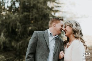 Engaged couple smiling at each other during their Rock Quarry Garden Engagement Session.