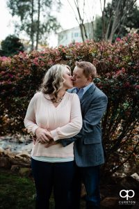 Man kissing his fiancee during their Rock Quarry Garden Engagement Session.
