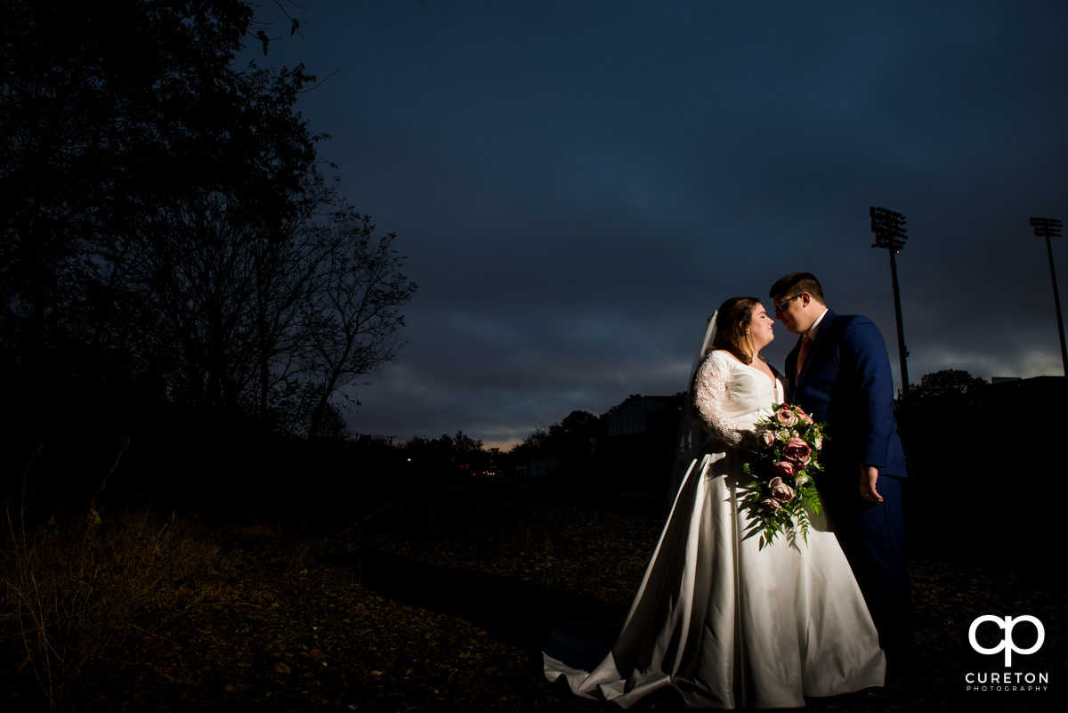 Bride and groom at sunset in front of Fluor field in downtown Greenville,SC on their wedding day.
