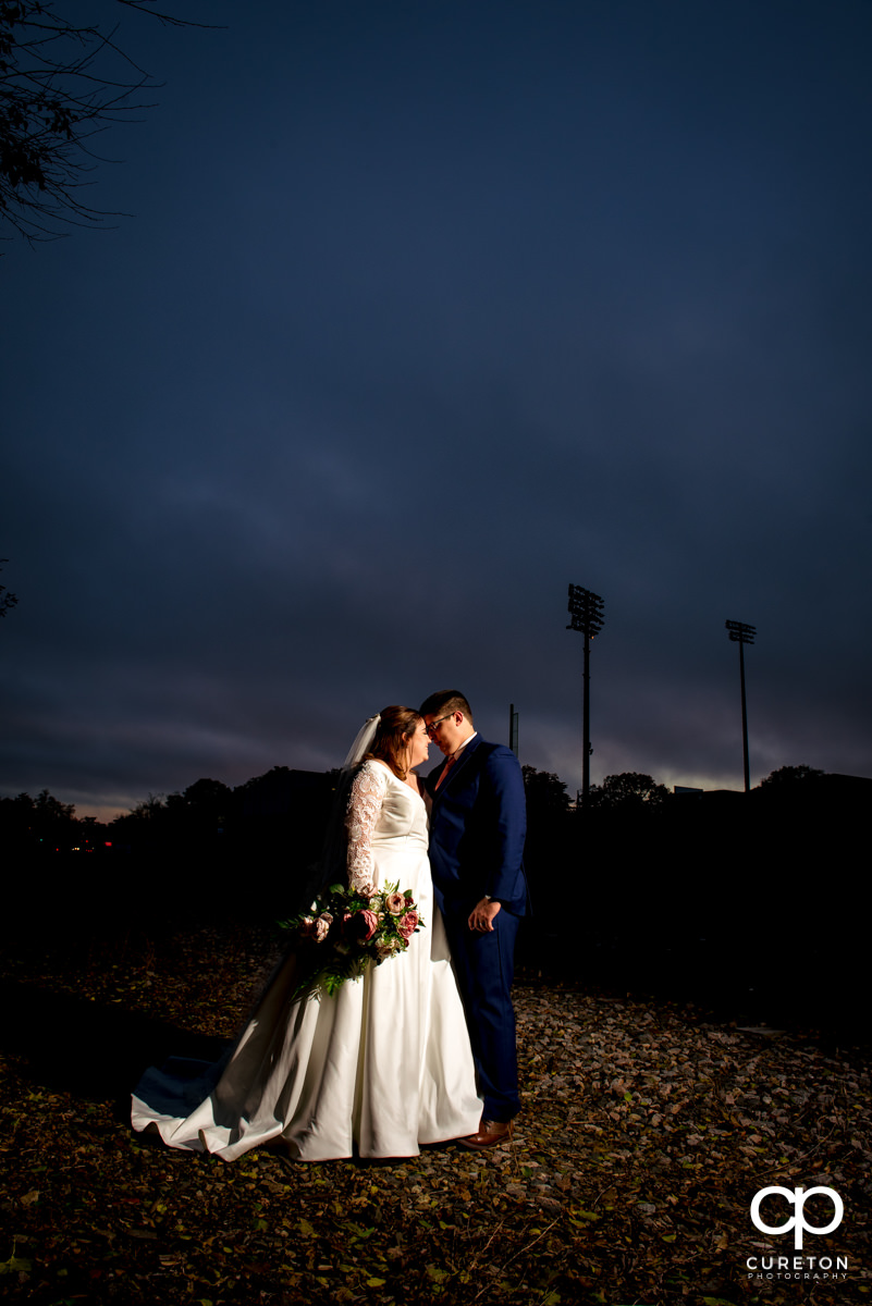 Bride and groom dancing at sunset at their downtown Greenville,SC wedding.