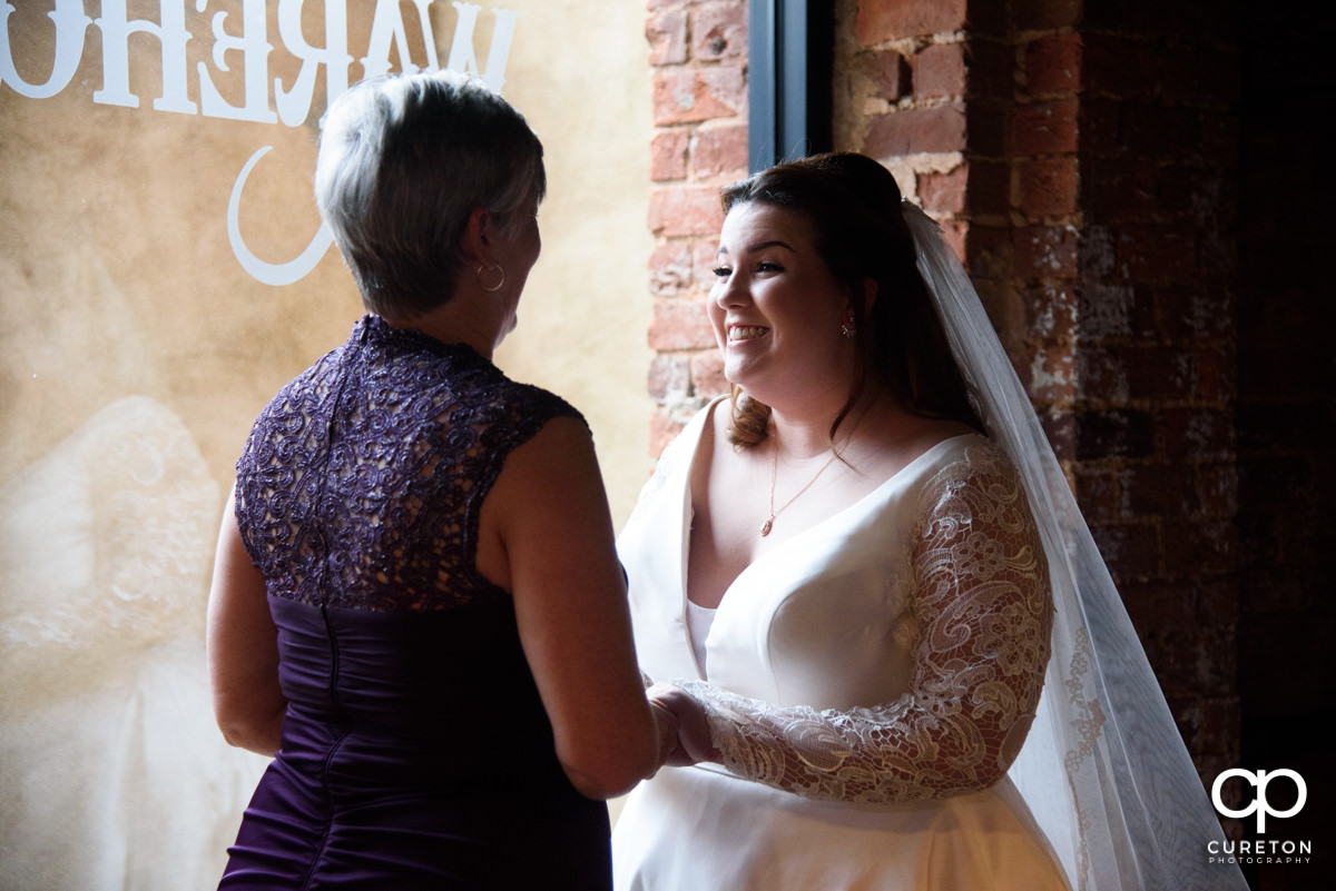 Bride and her mom hanging out before the ceremony.
