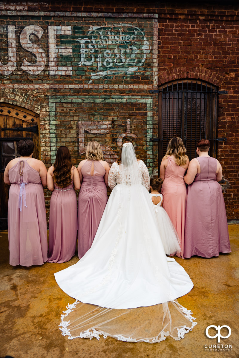 The back of the bride and bridesmaid's dresses.