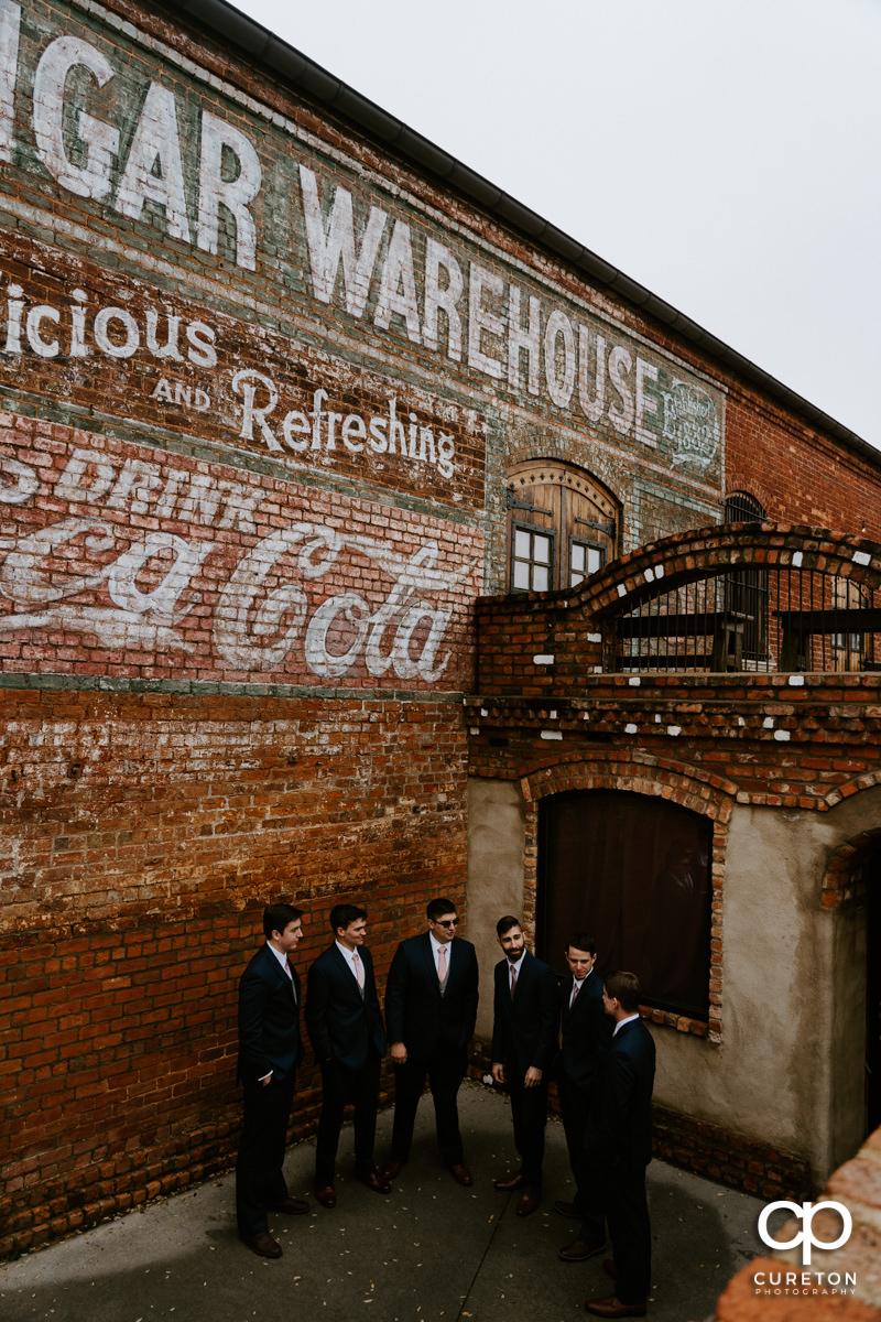 Groomsmen hanging out at eh Old Cigar Wareshouse.