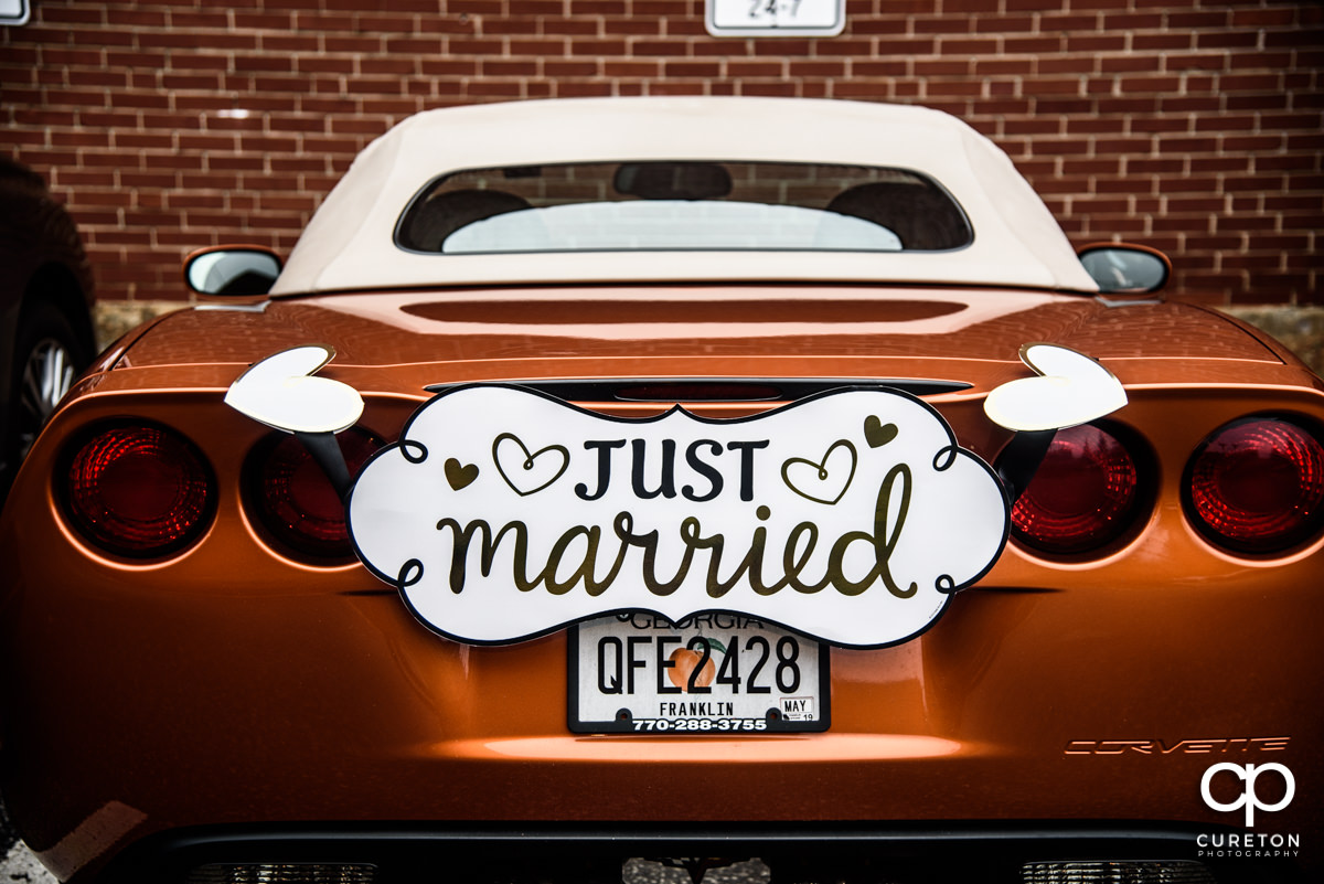Just married sign on the back of a Corvette.
