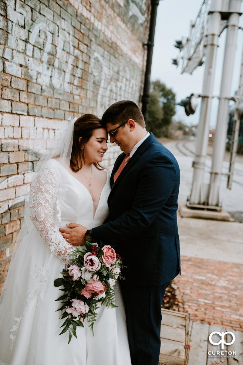 Groom dancing with his bride.