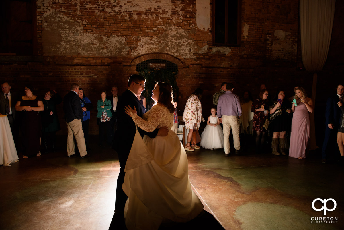 Bride and groom sharing a first dance at the Old Cigar Warehouse reception.