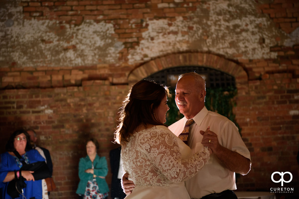 Bride and her father dancing.