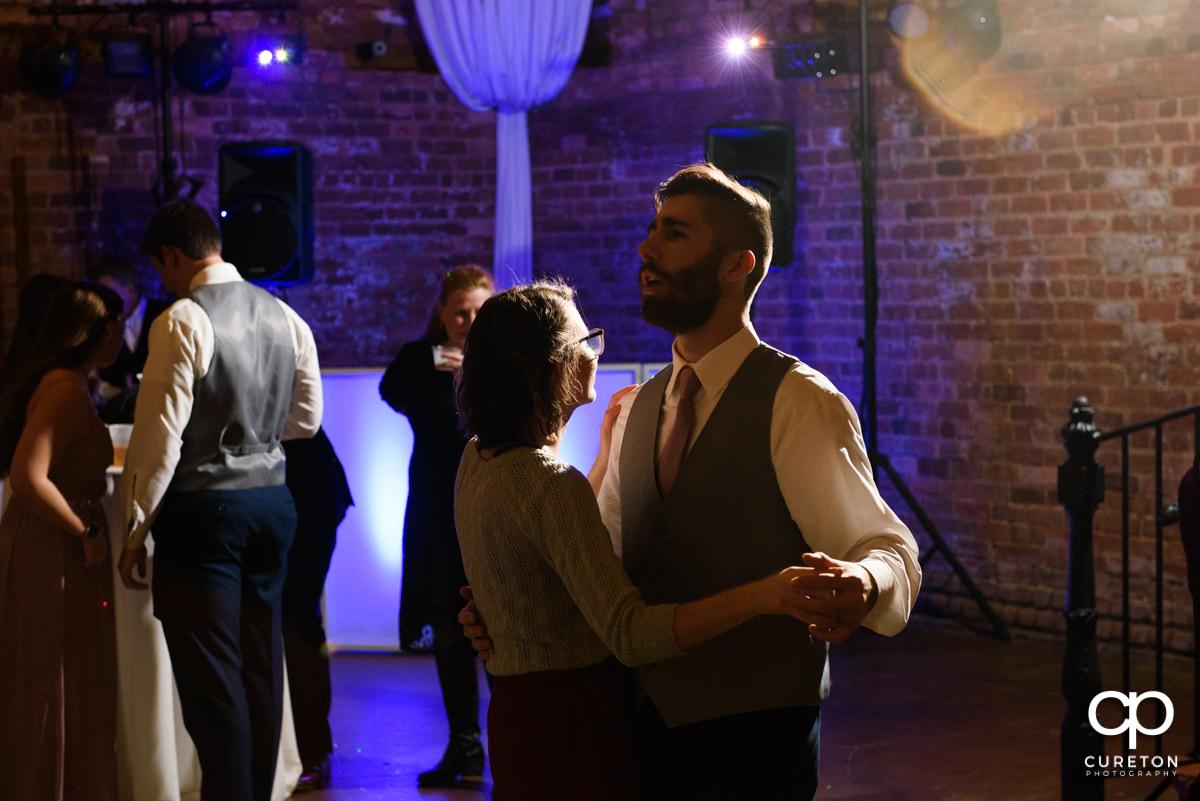 Wedding guests dancing at the wedding reception.