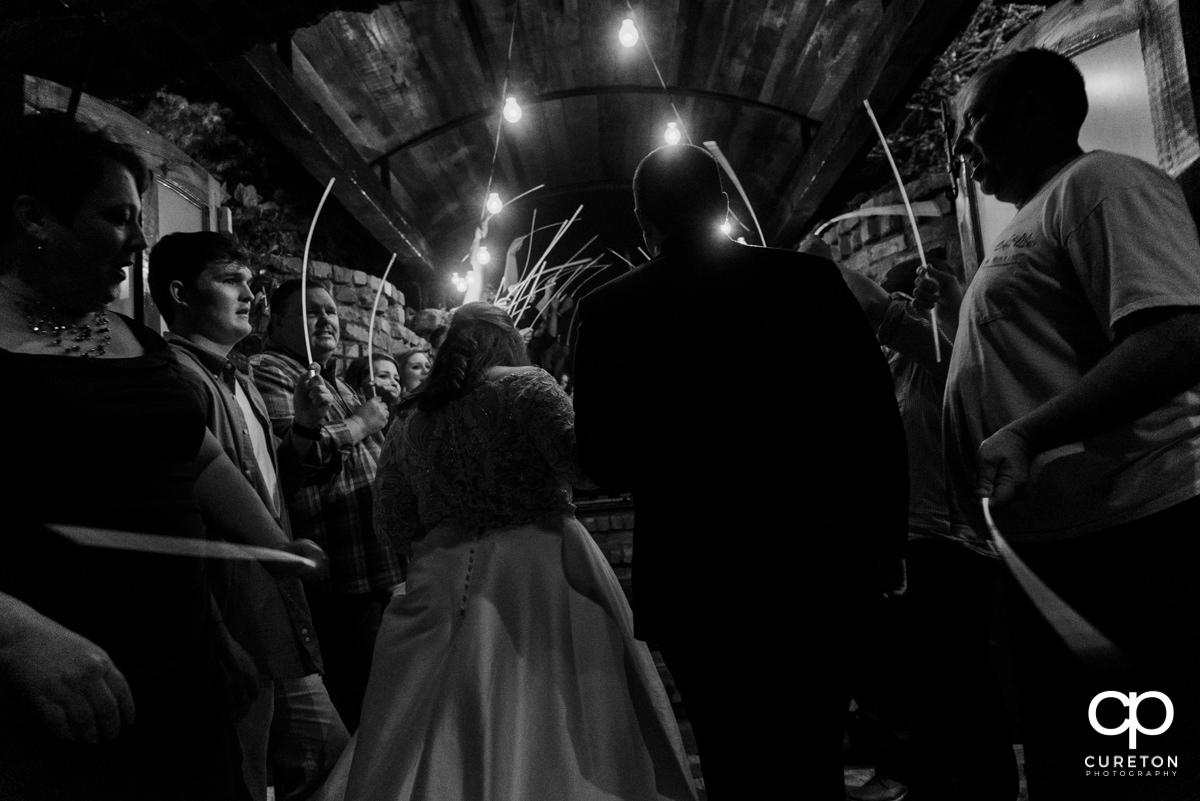 Bride and groom exit.