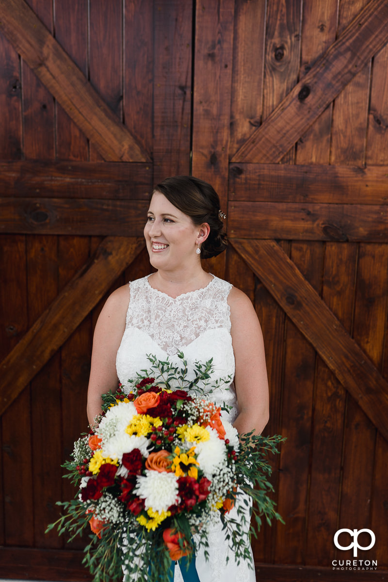 Bride in front of a barn door at Famoda Farms.