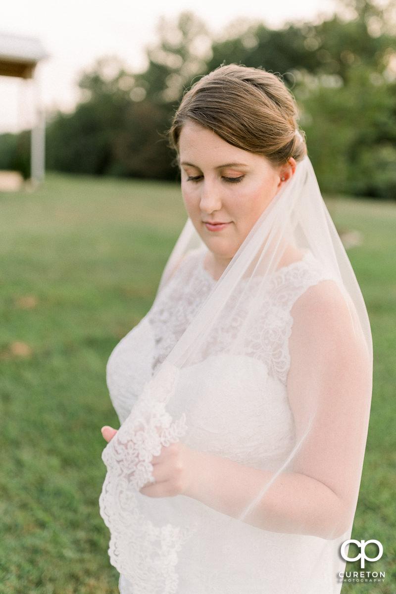 Bride holding her veil.