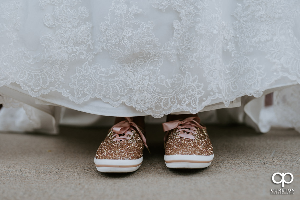 Bride's sparkly Keds shoes.