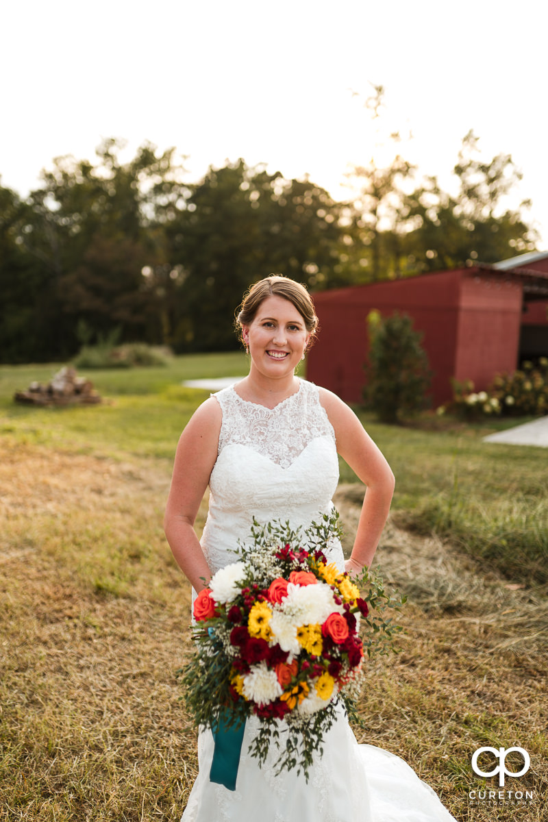 Bride in a field at golden hour.