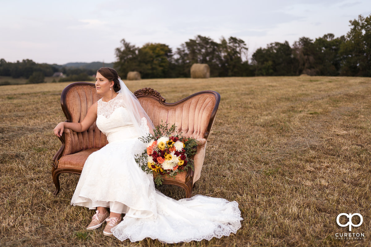 Bride on a vintage couch.