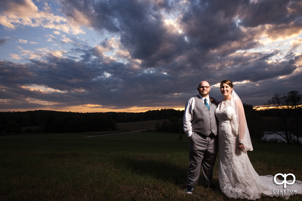 Bride and groom at sunset at Famoda Farm in Taylors,SC.