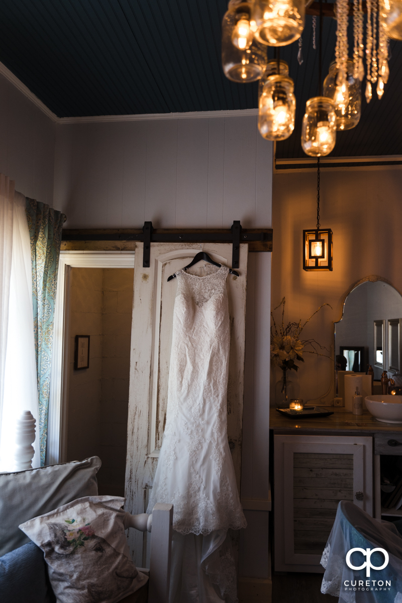 Bride's dress hangin in the bridal suite at Famoda Farm.
