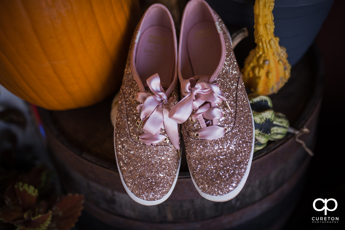 The bride's sparkly Keds shoes.