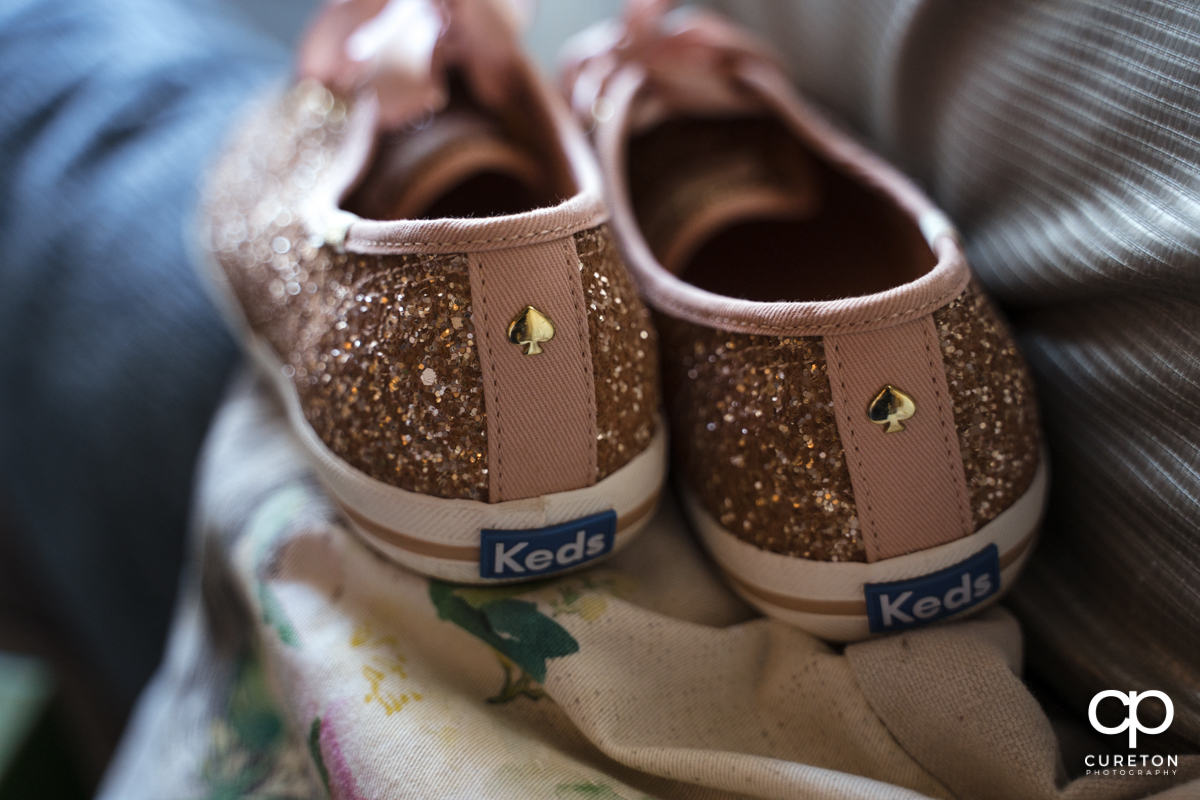 The bride's pink sparkly Keds.