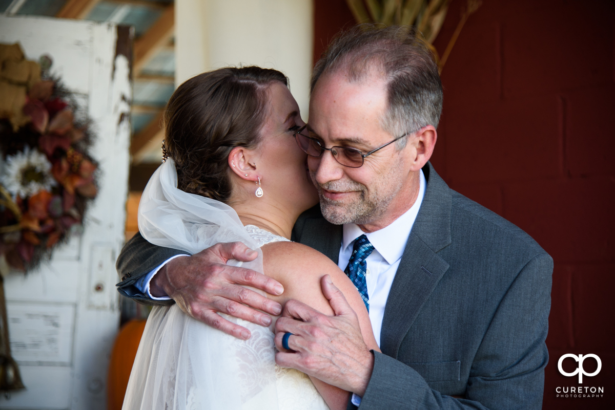 Bride hugging her dad before the ceremony.