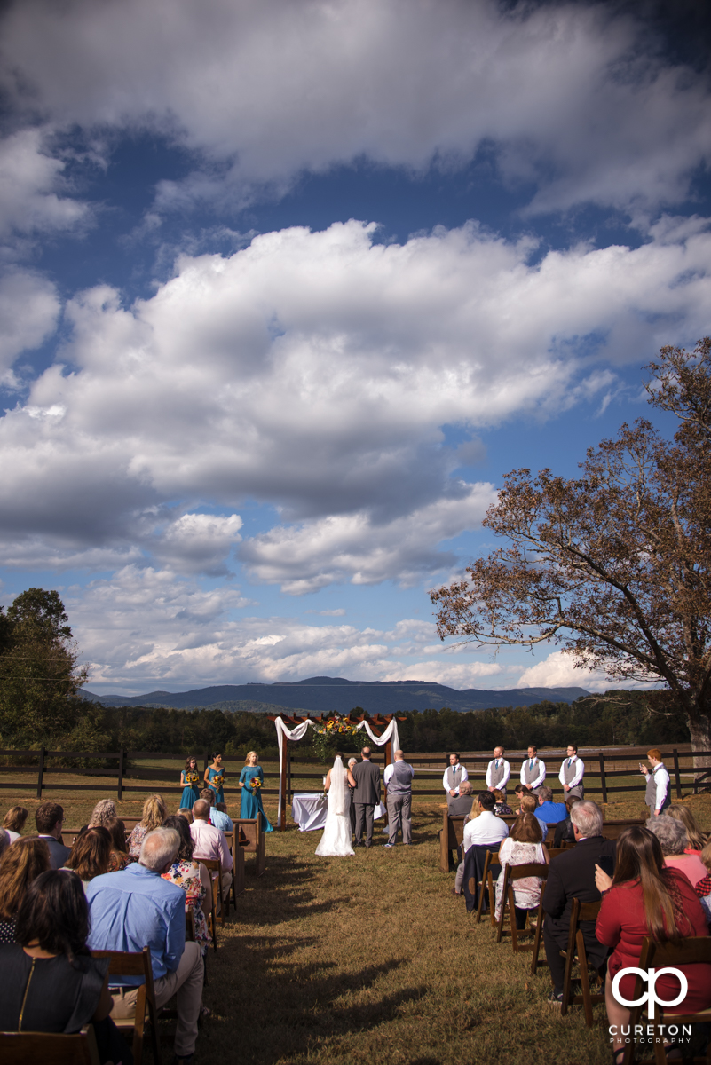 Wedding ceremony in front of the mountains.