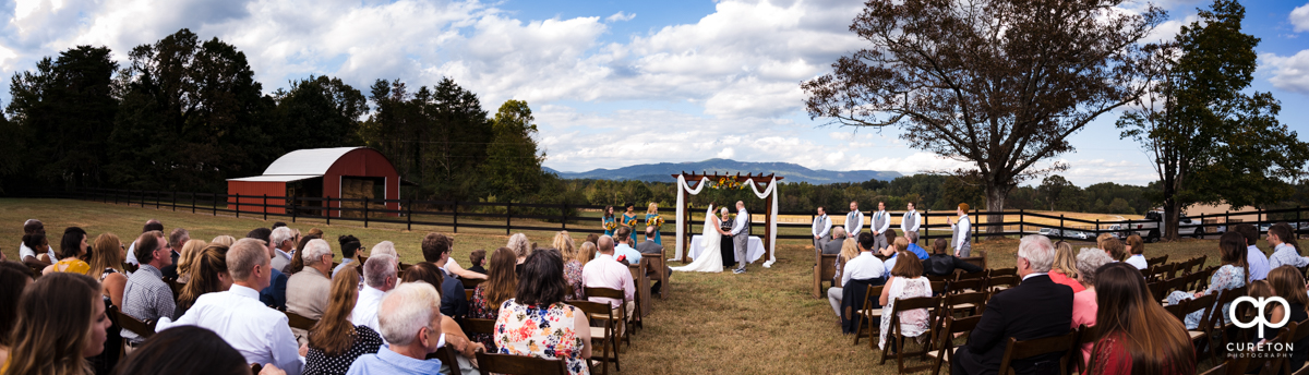 Panorama of a Famoda Farm wedding ceremony.