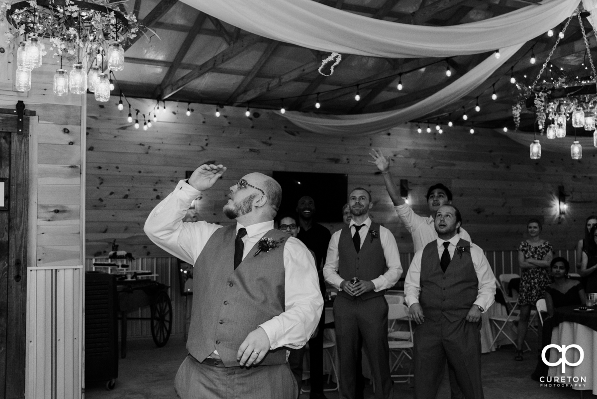 Groom tossing the garter.