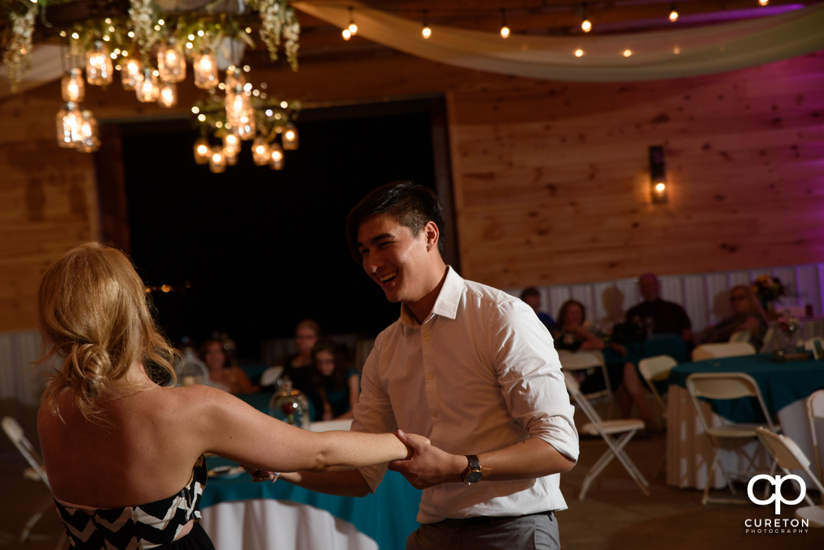 Guests dancing at the wedding reception.