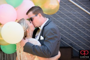 Groom kisses his bride during a first look.