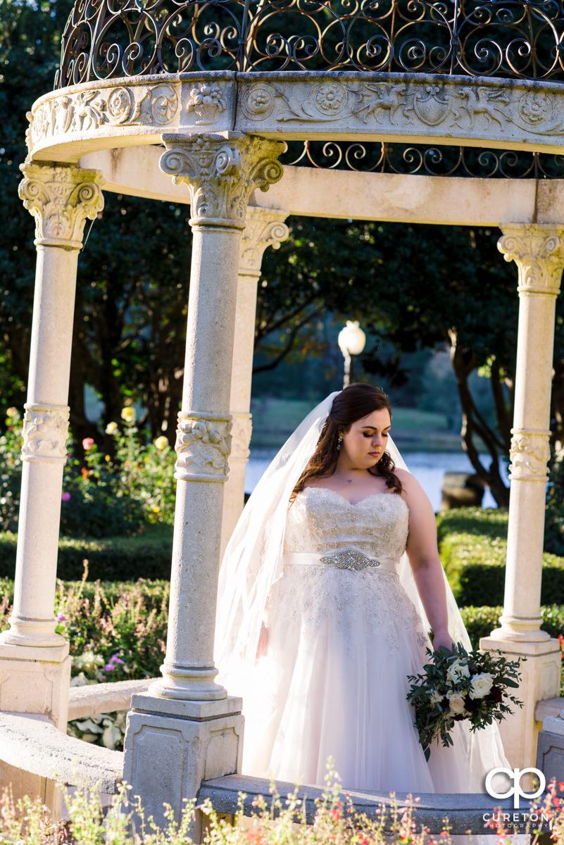 Bride standing in teh gazebo at the Furman University rose garden.