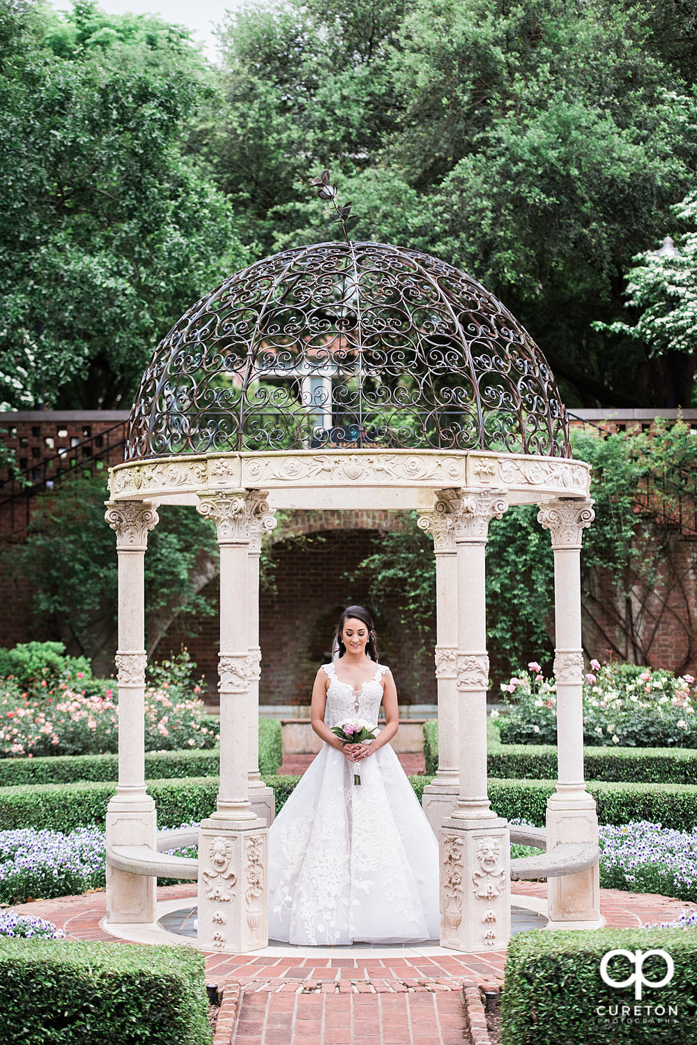Bride standing in the rose garden at Furman University.