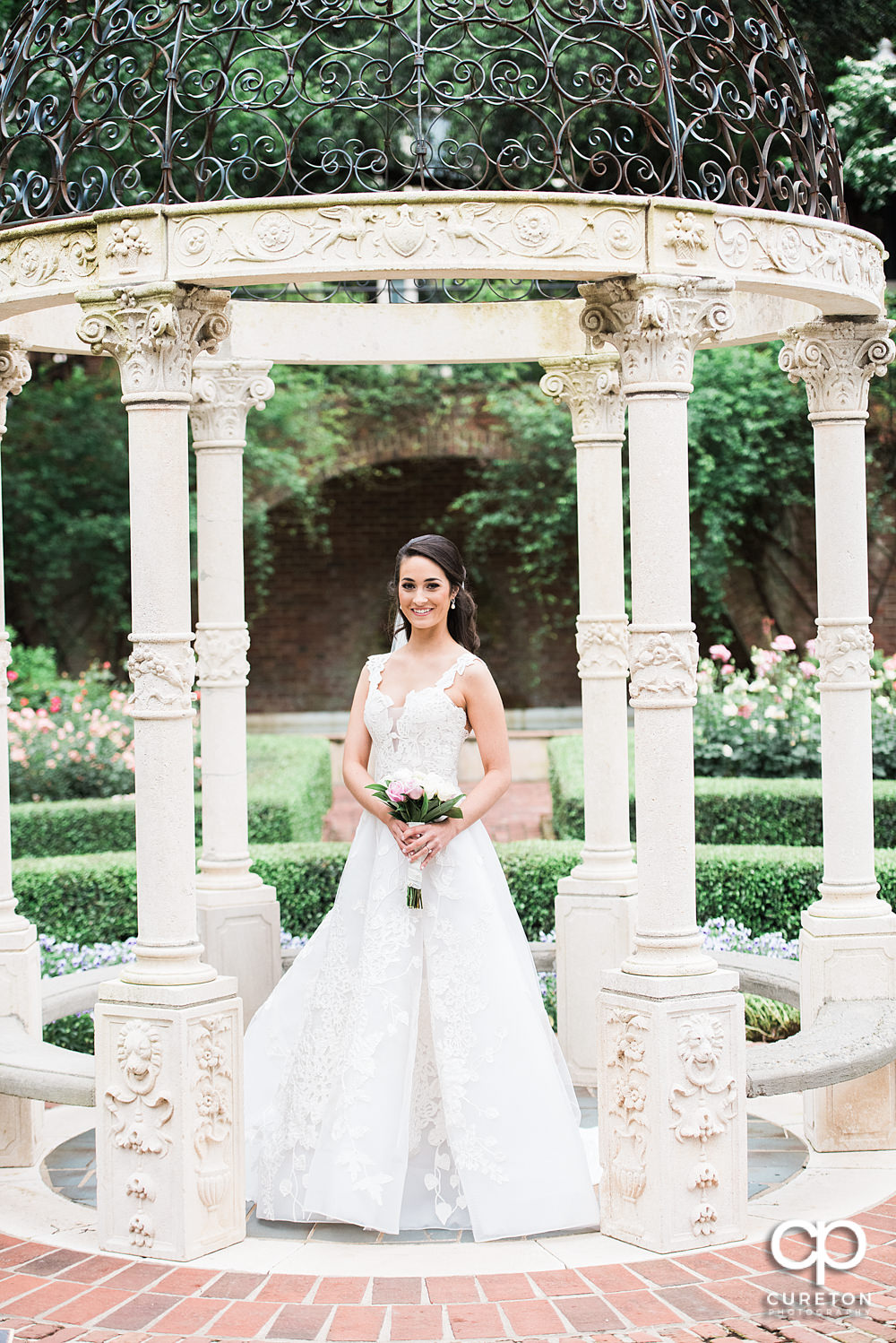 Bride under teh gazebo in the rose garden during her Furman University bridal session.