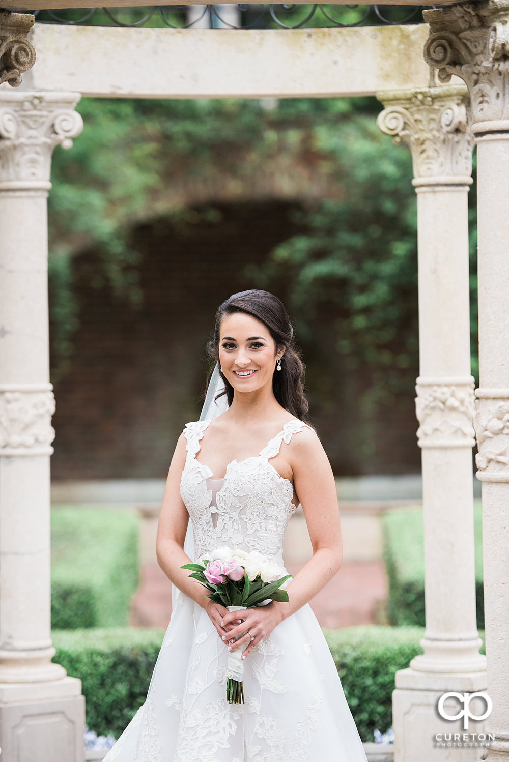 Bride smiling under the gazebo at Furman University.