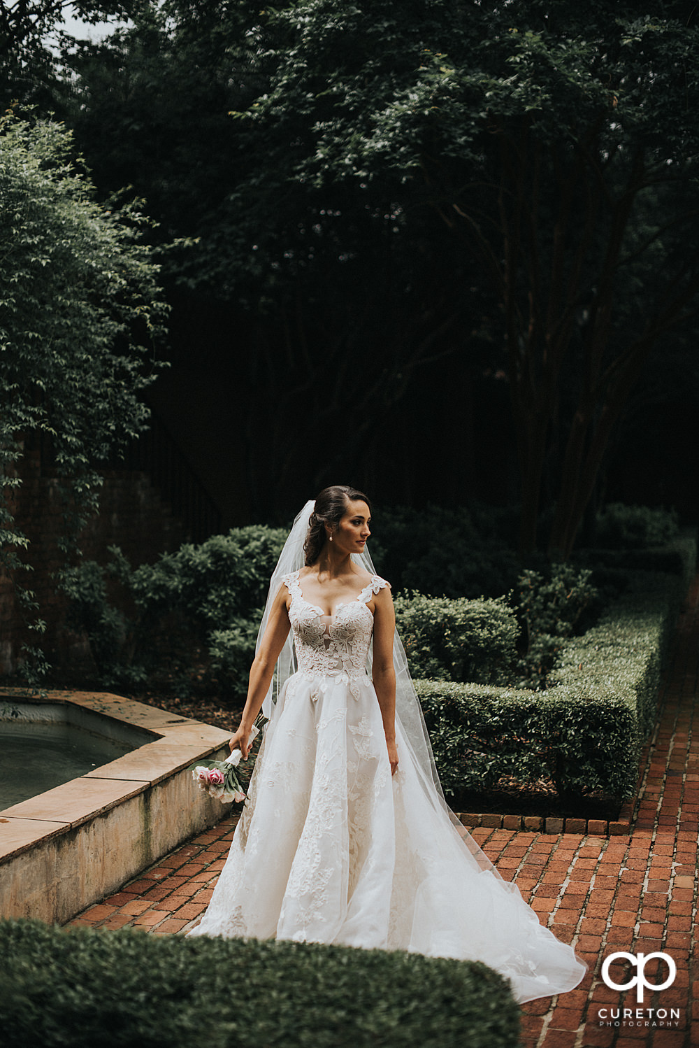 Bride standing in the garden at Furman.