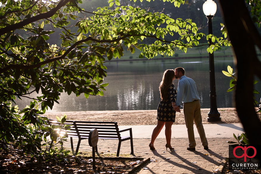 Beautiful light and an engaged couple by the lake at Furman.