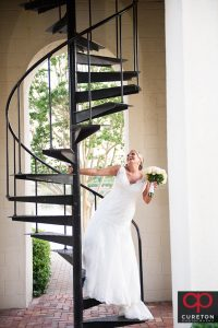 A bride on the staircase at the Bell Tower at the Furman campus.
