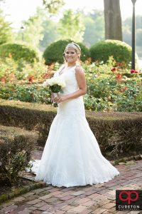 A bride posing in teh rose garden at Furman during her bridal session.