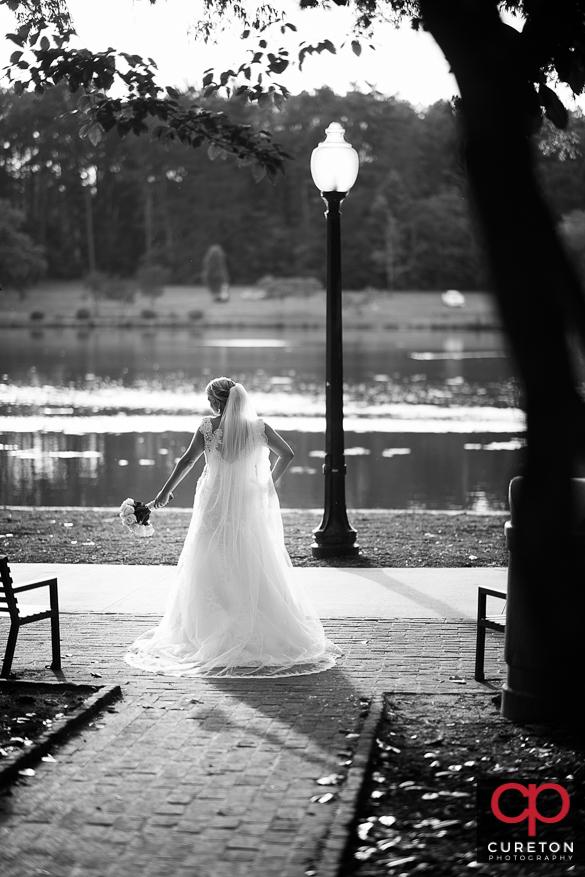 Black and white bridal by teh lake at Furman.
