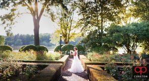 Bride smelling her flowers during a rose garden bridal session at Furman.