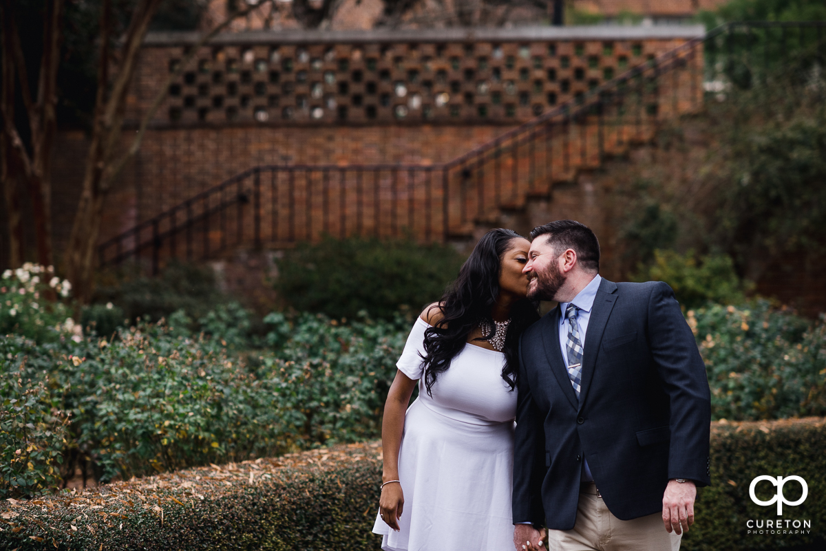 Woman kissing her fiancee.